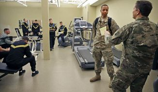 In this Jan. 2018 photo, Drill sergeant Peter Valitchka, right, talks with Sgt. Isaiah Joseph, a future drill sergeant, during training at the U.S. Army Reserve Center in Neenah, Wis. Valitchka, 49, is part of a U.S. Army Reserve unit based in Neenah made up entirely of drill instructors. They're responsible for basic training and working with new recruits, among other duties.(Ron Page/The Post-Crescent via AP)