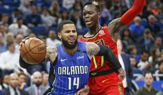 Orlando Magic guard D.J. Augustin (14) drives past Atlanta Hawks guard Dennis Schroder (17) during the second quarter of an NBA basketball game in Orlando, Fla., on Thursday, Feb. 8, 2018. (AP Photo/Reinhold Matay)
