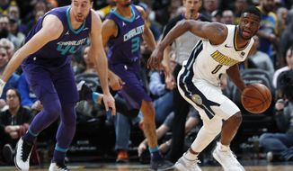 Denver Nuggets guard Emmanuel Mudiay, right, picks up a loose ball from Charlotte Hornets forward Frank Kaminsky in the second half of an NBA basketball game Monday, Feb. 5, 2018, in Denver. The Nuggets won 121-104. (AP Photo/David Zalubowski)