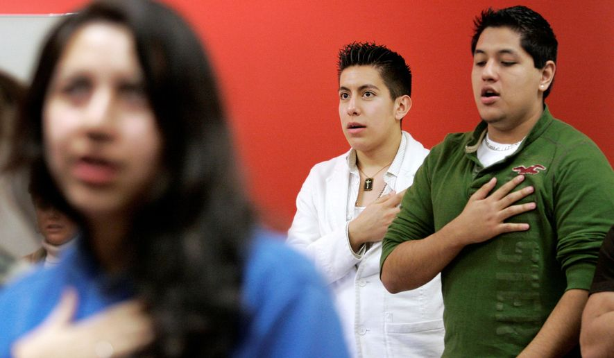 In this Thursday, Feb. 7, 2008, file photo Manuel Rendon, center in white, along with fellow members, recite the Pledge of Allegiance at a meeting of the Collin County LULAC Young Adults Council #4780 at Collin County Community College in Plano, Texas. The oldest Latino civil rights organization in the U.S. is facing turmoil over its leader's initial support for President Donald Trump's immigration plan and it comes amid evolving membership. League of United Latin American Citizens members are pressuring President Roger Rocha to resign after he wrote a letter in support of Trump's proposal on increased border security. (AP Photo/Tony Gutierrez,File)