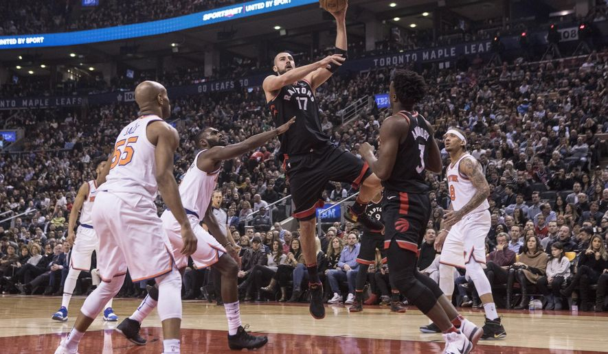 Toronto Raptors Jonas Valanciunas shoots against the New York Knicks during the first half of an NBA basketball game Thursday, Feb. 8, 2018, in Toronto. (Chris Young/The Canadian Press via AP)