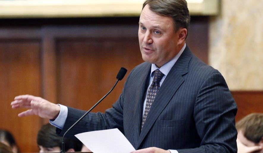 Rep. Jason White, R-West, explains the updating of various provisions relating to a Medicaid bill in the House chamber at the Capitol on Thursday, Feb. 8, 2018, in Jackson, Miss. (AP Photo/Rogelio V. Solis)