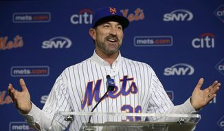 FILE - In this Oct. 23, 2017, file photo, New York Mets new manager Mickey Callaway gestures at the podium after he was introduced to the media during a baseball news conference at CitiField in New York. The former Cleveland Indians guru begins his first managerial job at any level next week when New York opens spring training in Port St. Lucie, Fla.  (AP Photo/Kathy Willens, File)