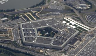 In this June 3, 2011, file photo, the Pentagon is seen from air from Air Force One. Defense Department investigators say the number of complaints filed against senior military and defense officials has increased over the past few years. But they say more cases are being rejected as not credible and fewer officers are being found guilty of misconduct. (AP Photo/Charles Dharapak, File)