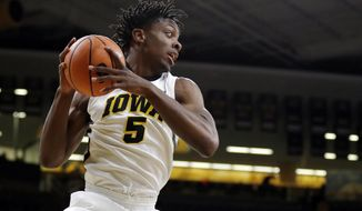 FILE - In this Jan. 30, 2018, file photo, Iowa forward Tyler Cook grabs a rebound during the first half of an NCAA college basketball game against Minnesota in Iowa City, Iowa. Cook, a 6-foot-9 sophomore forward out of St. Louis, has emerged as one of the best young post players in the league. (AP Photo/Charlie Neibergall, File)