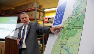FILE-- In this Aug. 15, 2015 file photograph, Bill Quinlan, President of Eversource Operations in New Hampshire, presents revised plans for the proposed Northern Pass hydroelectric project at Globe Manufacturing in Pittsfield, N.H. Massachusetts officials are demanding to know whether a hydro project that was rejected by New Hampshire regulators is still a viable option to delivering clean energy to the state by 2020. The $1.6 billion Northern Pass project was set to bring hydropower from Canada by creating a transmission line through New Hampshire for customers in southern New England. (Paul Hayes /Caledonian-Record via AP)