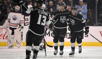 Los Angeles Kings left wing Kyle Clifford, second from left, celebrates his goal along with center Trevor Lewis, second from right, and center Torrey Mitchell as Edmonton Oilers goaltender Cam Talbot watches during the first period of an NHL hockey game, Wednesday, Feb. 7, 2018, in Los Angeles. (AP Photo/Mark J. Terrill)