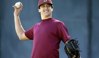 FILE - In this Jan. 13, 2015, file photo, Stanford pitcher Cal Quantrill throws during a workout in Stanford, Calif. Quantrill is one of the Padres top prospects invited to spring training.  (AP Photo/Marcio Jose Sanchez, File)