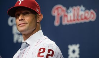 FILE - In this Nov. 2, 2017, file photo, the Philadelphia Phillies' new manager, Gabe Kapler, listens to a reporter's question during a news conference in Philadelphia. Kapler replaced Pete Mackanin, who moved into a front-office role. Kapler was an unconventional choice for the Phillies after spending the past three seasons as the director of player development for the Dodgers. He has limited managerial experience but is a progressive thinker. (AP Photo/Matt Rourke, File)