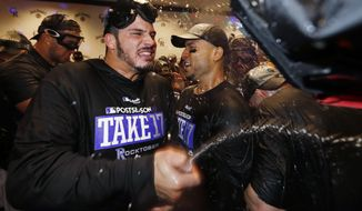 FILE - In this Sept. 30, 2017, file photo, Colorado Rockies third baseman Nolan Arenado, left, and right fielder Carlos Gonzalez celebrate with teammates after securing a National League Wild Card berth after a baseball game against the Los Angeles Dodgers in Denver. The Rockies are counting on big seasons from Arenado and center fielder Charlie Blackmon along with bounce-back campaigns from other position players to make a run at back-to-back playoff appearances for the first time in team history. (AP Photo/David Zalubowski, File)