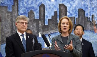 Seattle City Attorney Pete Holmes, left, looks on as Mayor Jenny Durkan speaks at a news conference announcing plans for the city to move to vacate misdemeanor marijuana possession convictions, Thursday, Feb. 8, 2018, in Seattle. City Council member Bruce Harrell looks on at right. Five years after Washington state legalized marijuana, Seattle officials say they're moving to automatically clear past misdemeanor convictions for pot possession. San Francisco recently took the same step. (AP Photo/Elaine Thompson)