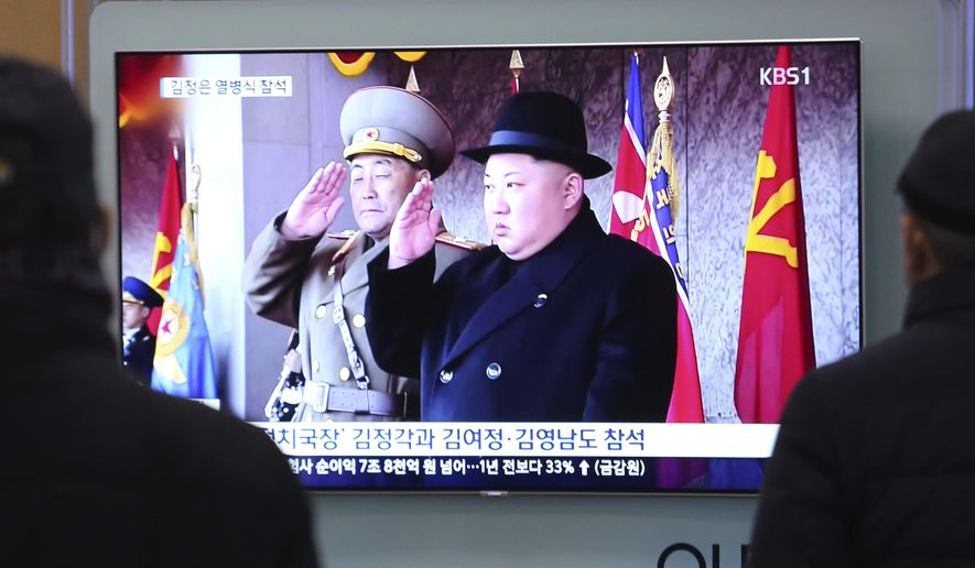 People watch a TV showing North Korean leader Kim Jong Un during a military parade in Pyongyang, North Korea, at Seoul Railway Station in Seoul, South Korea, Thursday, Feb. 8, 2018. North Korean leader Kim Jong Un presided over an extravagant military parade in Pyongyang's Kim Il Sung Square on Thursday, grabbing the spotlight on the eve of the Pyeongchang Winter Olympics in South Korea to thumb his nose at Washington while making a point of showing off his new-found restraint toward Seoul.(AP Photo/Ahn Young-joon)
