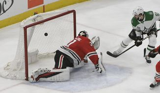 Dallas Stars center Tyler Seguin (91) scores a goal on Chicago Blackhawks goaltender Anton Forsberg (31) during the second period of an NHL hockey game Thursday, Feb. 8, 2018, in Chicago. (AP Photo/David Banks)