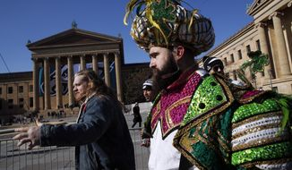 Philadelphia Eagles center Jason Kelce, right, arrives in front of the Philadelphia Museum of Art after a Super Bowl victory parade for the Philadelphia Eagles football team, Thursday, Feb. 8, 2018, in Philadelphia. The Eagles beat the New England Patriots 41-33 in Super Bowl 52. (AP Photo/Alex Brandon)