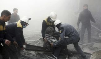 This photo provided by the Syrian Civil Defense White Helmets, which has been authenticated based on its contents and other AP reporting, shows civil defense workers carrying a wounded man after airstrikes hit a rebel-held suburb near Damascus, Syria, Thursday, Feb. 8, 2018. Syrian rescue workers and activists say the death toll from ongoing government strikes on the opposition-held region near the capital Damascus has risen to at least 35. (Syrian Civil Defense White Helmets via AP)