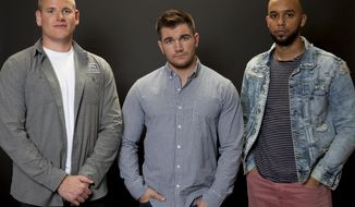 """In this Jan. 27, 2018 photo, Spencer Stone, from left, Alek Skarlatos, and Anthony Sadler, pose for a portrait to promote the film """"15:17 to Paris"""" at the Four Seasons Hotel in Los Angeles. The trio, who famously thwarted a potential terrorist attack in August 2015 on a Paris-bound train, play themselves in the film. (Photo by Rebecca Cabage/Invision/AP)"""