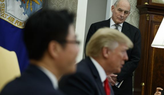FILE - In this Feb. 2, 2018, file photo, White House Chief of Staff John Kelly listens during a meeting between President Donald Trump and North Korean defectors in the Oval Office of the White House in Washington. The White House says Trump remains confident in Kelly even though Kelly defended an aide who'd been accused of domestic abuse by his two ex-wives. Spokesman Raj Shah says Trump was not aware of the allegations against former staff secretary Rob Porter until Tuesday. (AP Photo/Evan Vucci)