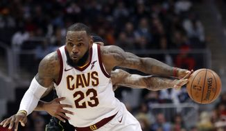 Cleveland Cavaliers forward LeBron James (23) has the ball knocked away by Atlanta Hawks guard Malcolm Delaney (5) during the second half of an NBA basketball game Friday, Feb. 9, 2018, in Atlanta. Cleveland won 123-107. (AP Photo/John Bazemore) ** FILE **