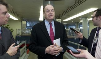 Sen. Richard Shelby R-AL speaks with the media as he walks to the senate chamber, Friday, Feb. 9, 2018, at Capitol Hill in Washington. (AP Photo/Jose Luis Magana)