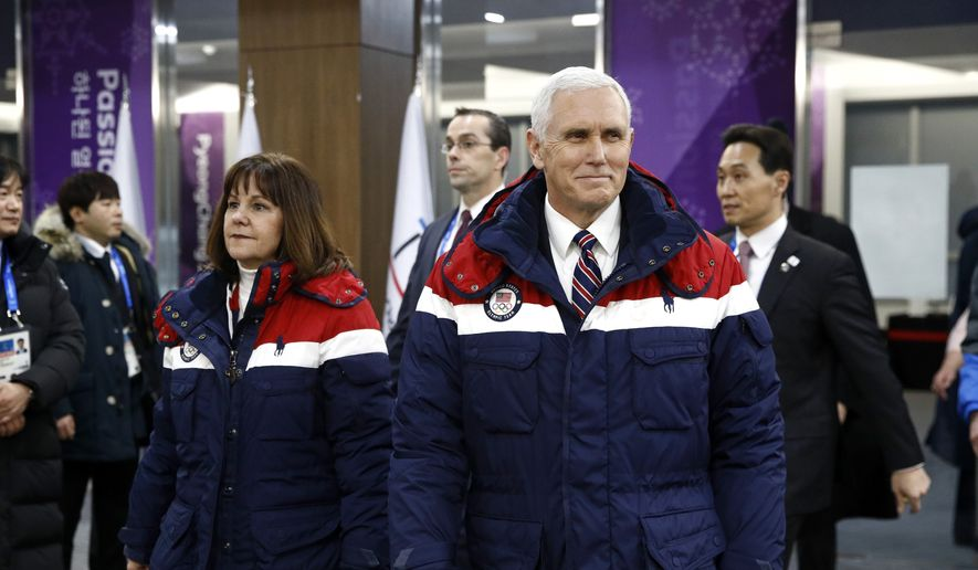Vice President Mike Pence, right, walks to his seat alongside second lady Karen Pence at the opening ceremony of the 2018 Winter Olympics in Pyeongchang, South Korea, Friday, Feb. 9, 2018. (AP Photo/Patrick Semansky, Pool)
