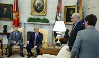 President Donald Trump speaks with White House Chief of Staff John Kelly, second from right, and White House deputy press secretary Hogan Gidley, right, after meeting with Don Bouvet, left, in the Oval Office of the White House, Friday, Feb. 9, 2018, in Washington. (AP Photo/Evan Vucci) ** FILE **