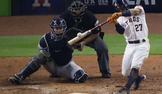 FILE - In this Oct. 21, 2017, file photo, Houston Astros' Jose Altuve hits a home run during the fifth inning of Game 7 of baseball's American League Championship Series against the New York Yankees, in Houston. Altuve, last year's AL MVP, return to anchor the middle of the order. (AP Photo/Charlie Riedel, File)