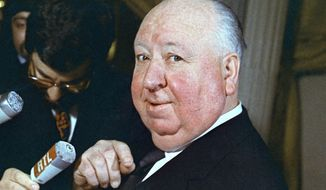 "FILE - This 1972 file photo shows British film director Alfred Hitchcock. Nearly 40 years after his death, Hitchcock remains a brand name in the thriller genre, not just among directors, but for crime writers who look to ""Shadow of a Doubt,"" ""Vertigo"" and others works as models for narrative and mood. Although much of his work was adapted from novels and short fiction, Hitchcock is the only filmmaker to receive a ""grand master"" Edgar award from the Mystery Writers of America. (AP Photo, File)"