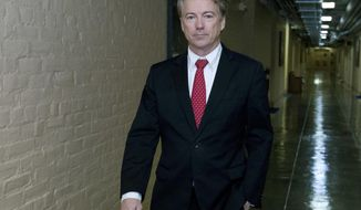 Sen. Rand Paul, R-Ky., walks to his office after speaking in the senate floor, at the Capitol, Thursday, Feb. 8, 2018, in Washington. (AP Photo/Jose Luis Magana)