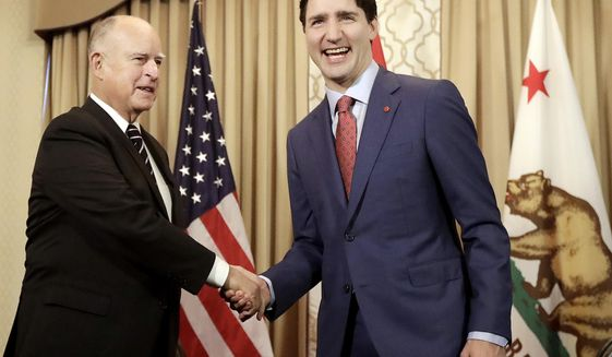 Canada's Prime Minister Justin Trudeau, right, shakes hands with California Gov. Jerry Brown during a meeting in San Francisco, Friday, Feb. 9, 2018. (AP Photo/Jeff Chiu, Pool)