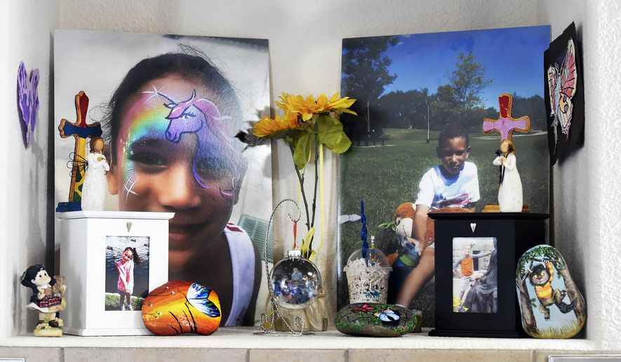 This Feb. 1, 2018 photo shows photos and memorabilia of Noah and Sophia Murphy in in Colorado Springs, Colo. Parents Melissa and Vinnie Murphy tragically lost their children, Noah, 7, and Sophia, 5, last year when they were stabbed to death. Their older brother, Malik Murphy, was charged with the murders. Above their fireplace, are photos and memorabilia of Noah and Sophia. (Jerilee Bennett/The Gazette via AP)