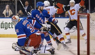 Calgary Flames' Brett Kulak, right celebrates after scoring against the New York Rangers during the first period of an NHL hockey game Friday, Feb. 9, 2018, at Madison Square Garden in New York. (AP Photo/Andres Kudacki)