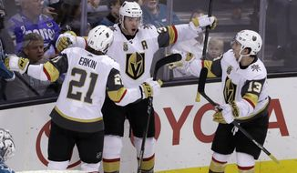 Vegas Golden Knights' Brayden McNabb, center, celebrates his goal with teammates Cody Eakin, left, and Brendan Leipsic during the third period of an NHL hockey game against the San Jose Sharks on Thursday, Feb. 8, 2018, in San Jose, Calif. (AP Photo/Marcio Jose Sanchez)