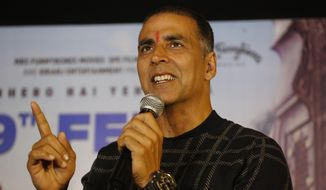 """File - In this Feb. 9, 2018, file photo, Bollywood actor Akshay Kumar speaks during a press conference to promote his upcoming movie """"Pad Man"""" in Ahmadabad, India. (AP Photo/Ajit Solanki, File)"""