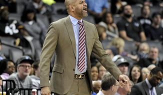 Memphis Grizzlies interim coach J.B. Bickerstaff calls to players during the second half of an NBA basketball game against the Utah Jazz on Wednesday, Feb. 7, 2018, in Memphis, Tenn. (AP Photo/Brandon Dill)