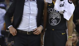 Golden State Warriors coach Steve Kerr, left, and Stephen Curry react to a technical foul called against Draymond Green during the first half of the team's NBA basketball game against the Dallas Mavericks on Thursday, Feb. 8, 2018, in Oakland, Calif. (AP Photo/Ben Margot)
