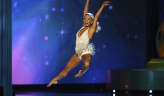 FILE - In this Sept. 11, 2016, file photo, Savvy Shields, a University of Arkansas art major, dances at the Miss America pageant in Atlantic City, N.J. Shields won the competition and served as Miss America until September 2017. After an Arkansas politician criticized a billboard promoting the University of Arkansas' dance program and said schools should promote other skills, Shields said the state needs entertainers and engineers. (AP Photo/Mel Evans, File)