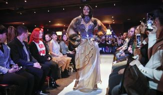 Melissa Davis, 22, models #MeToo fashion during Fashion Week, Friday Feb. 9, 2018, in New York. Davis, a model and actress from Guyana, was among a small group of sexual misconduct survivors using the #MeToo moment and fashion to share their stories and empower other survivors. (AP Photo/Bebeto Matthews)