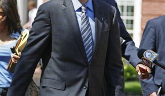 FILE - In this Friday, April 30, 2010 file photo, David Kernell walks from the federal courthouse in Knoxville, Tenn. A relative says Kernell, a man who hacked the personal email account of former Republican vice presidential nominee Sarah Palin in 2008 has died. (AP Photo/Lisa Norman-Hudson, File)