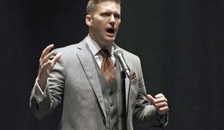 "FILE - In this Oct. 19, 2017, file photo, white nationalist Richard Spencer speaks at the University of Florida in Gainesville, Fla. Kent State University in Kent, Ohio, faced a deadline Friday, Feb. 9, 2018, to agree to rent space for Spencer's campus tour at an ""acceptable date and time,"" or become the latest university to face a lawsuit over the tour. Tour organizer Cameron Padgett wanted Spencer to speak at the Ohio school on May 4, 2018, the anniversary of shootings that killed four students during Vietnam war protests in 1970, but the university said it couldn't accept the request because early May was too busy with activities around the end of the academic year. (AP Photo/Chris O'Meara, File)"