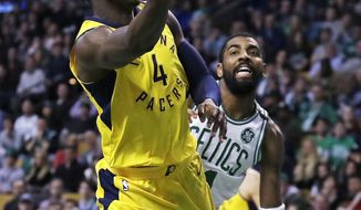 Indiana Pacers guard Victor Oladipo (4) drives to the basket past Boston Celtics guard Kyrie Irving, right, during the second half of an NBA basketball game in Boston, Friday, Feb. 9, 2018. (AP Photo/Charles Krupa)