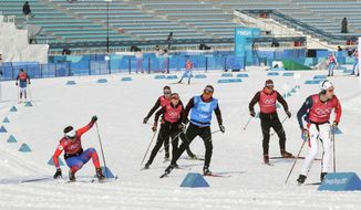 Athletes attend a training session at the Alpensia Cross-Country Skiing Centre ahead of the 2018 Winter Olympics in Pyeongchang, South Korea, Friday, Feb. 9, 2018. (AP Photo/Dmitri Lovetsky)