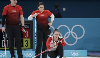 Switzerland Jenny Perret, right, shouts instructions as United States' siblings Matt Hamilton, right and Becca watch during their mixed doubles curling match at the 2018 Winter Olympics in Gangneung, South Korea, Friday, Feb. 9, 2018. (AP Photo/Aaron Favila)