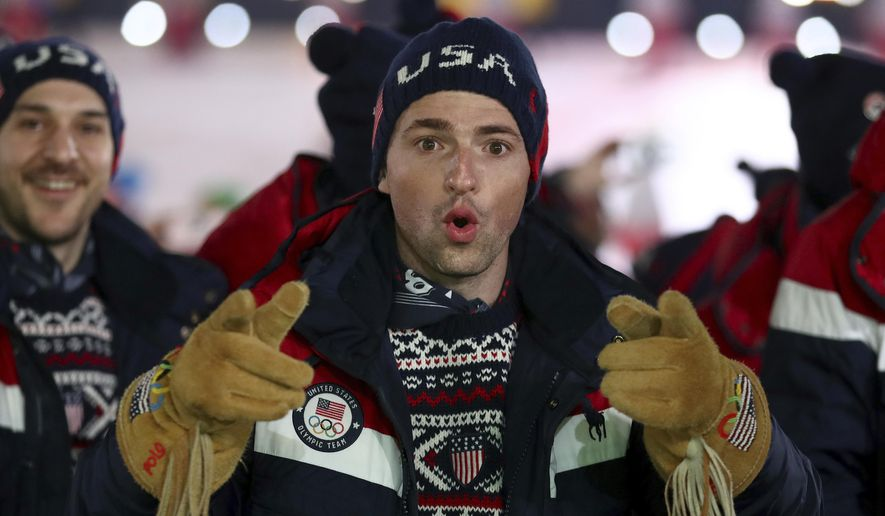 An athlete from team USA points during the opening ceremony of the 2018 Winter Olympics in Pyeongchang, South Korea, Friday, Feb. 9, 2018. (Clive Mason/Pool Photo via AP)