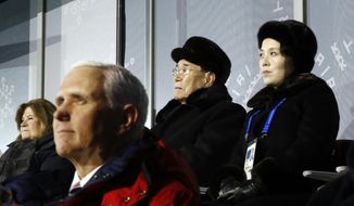 Kim Yo-jong, top right, sister of North Korean leader Kim Jong-un, sits alongside Kim Yong-nam, president of the Presidium of North Korean Parliament, and behind U.S. Vice President Mike Pence as she watches the opening ceremony of the 2018 Winter Olympics in Pyeongchang, South Korea, Friday, Feb. 9, 2018. (AP Photo/Patrick Semansky, Pool)