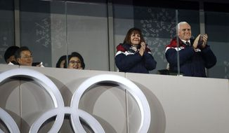 The United State Vice President Mike Pence, right, and his wife Karen Pence applaud during the opening ceremony of the 2018 Winter Olympics in Pyeongchang, South Korea, Friday, Feb. 9, 2018. (AP Photo/Jae C. Hong)