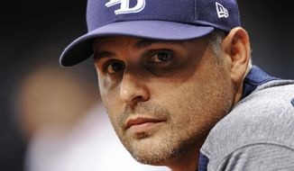 FILE - In this May 10, 2017, file photo, Tampa Bay Rays manager Kevin Cash looks on from the dugout during a baseball game against the Kansas City Royals in St. Petersburg, Fla. The Rays finished 80-82 in 2017, their fourth consecutive losing record on the heels of a stretch in which they made the playoffs four times in six seasons.  (AP Photo/Steve Nesius, File)