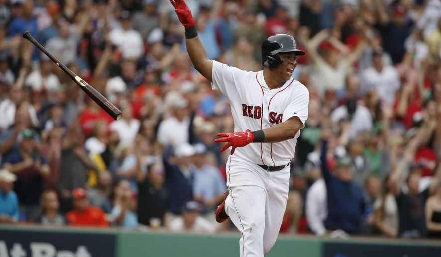 FILE - In this Oct. 8, 2017, file photo, Boston Red Sox's Rafael Devers tosses his bat after hitting a two-run home run against the Houston Astros during the third inning in Game 3 of baseball's American League Division Series, in Boston. Third baseman Devers hit .284 with 10 homers and 30 RBIs in 58 games as a 20-year-old; a full season from him is the best hope for a power boost. (AP Photo/Michael Dwyer, File)