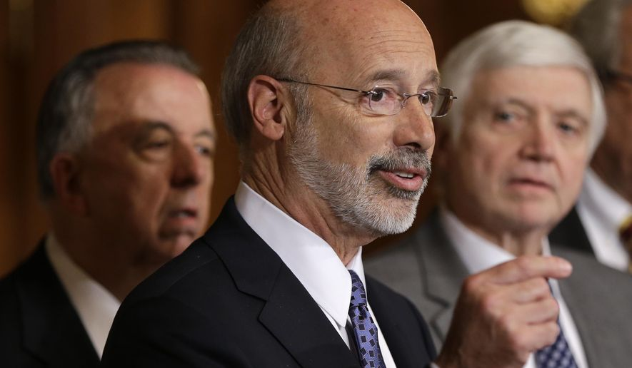 FILE - In this Oct. 7, 2015, file photo, Pennsylvania Gov. Tom Wolf, center, accompanied by state House Minority Leader Rep. Frank Dermody, right, D-Allegheny, and state Rep. Joe Markosek, left, D-Allegheny, discuss state budget negotiations at the state Capitol in Harrisburg, Pa. Republican leaders of the Pennsylvania Legislature said Friday, Feb. 9, 2018, that they've agreed to a proposed new map of congressional districts to replace one thrown out last month, but Wolf issued a statement earlier that day raising doubts about whether the Republican leaders' proposed map would suffice. Dermody, the House Democratic leader, said his members had no role in producing the plan. (AP Photo/Matt Rourke, File)