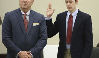 David Eisenhauer, right, next to his defense attorney Tony Anderson, left, during a hearing in Montgomery County Circuit Court in Christiansburg, Va., Friday, Feb. 9 2018. Eisenhauer, a former Virginia Tech student, pleaded no contest on Friday, in the 2016 killing of a 13-year-old girl. A plea of no contest means a defendant acknowledges there's enough evidence to convict him, but doesn't admit he committed the crime. The plea has the same effect as a guilty plea. (Matt Gentry/The Roanoke Times via AP, Pool)