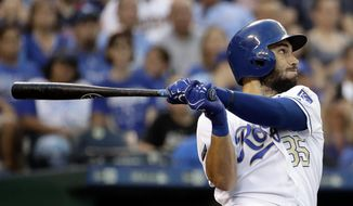 FILE - In this June 30, 2017, file photo, Kansas City Royals' Eric Hosmer hits a three-run home run during the fourth inning of a baseball game against the Minnesota Twins, in Kansas City, Mo. Perhaps 100 free agents still seek contracts as the start of spring training workouts on Feb. 14 draws near, a group that includes J.D. Martinez, Eric Hosmer, Mike Moustakas, Jake Arrieta and Yu Darvish.(AP Photo/Charlie Riedel, File)